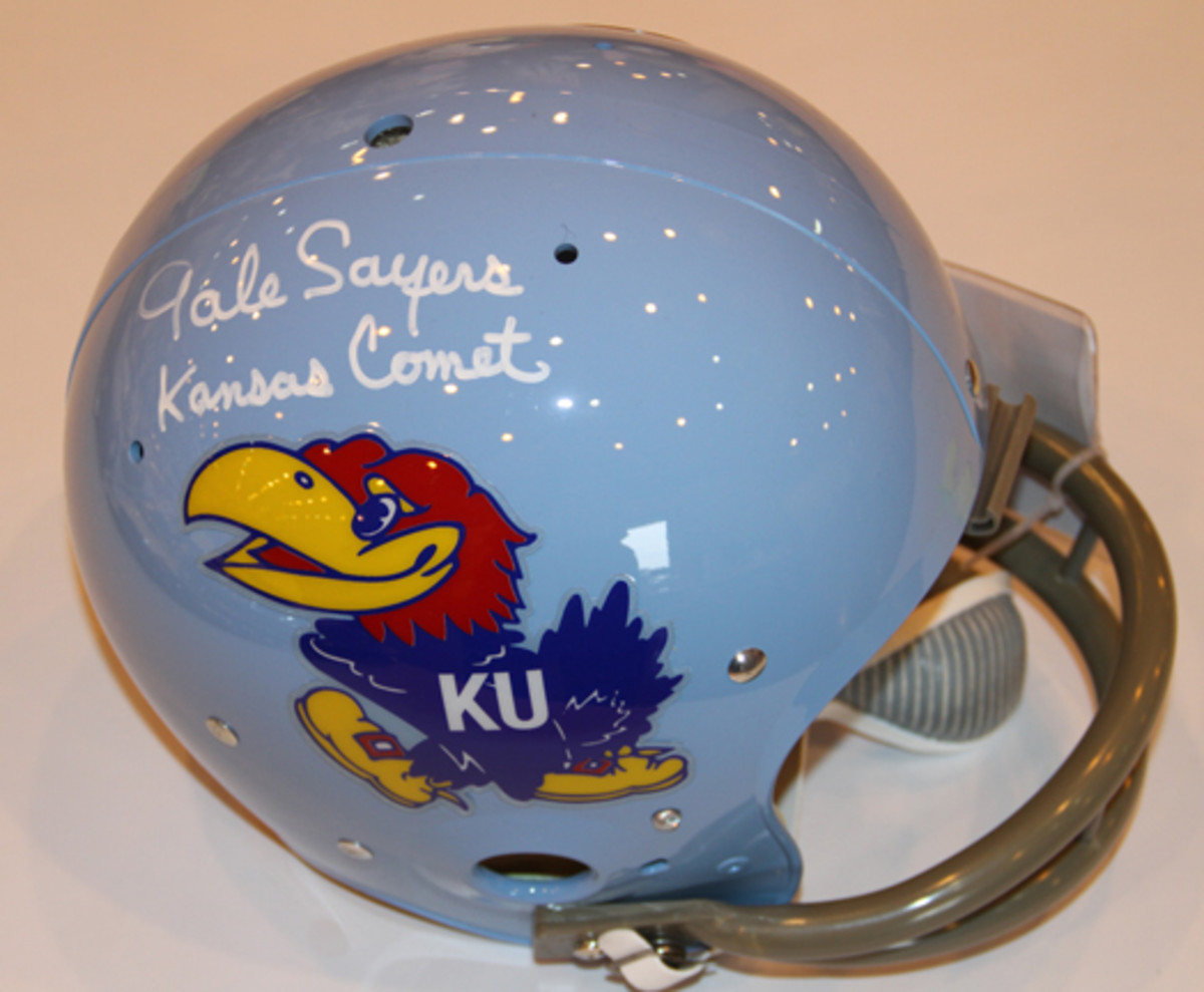 On the show floor was this Gale Sayers signed University of Kansas full-size helmet available for $209.