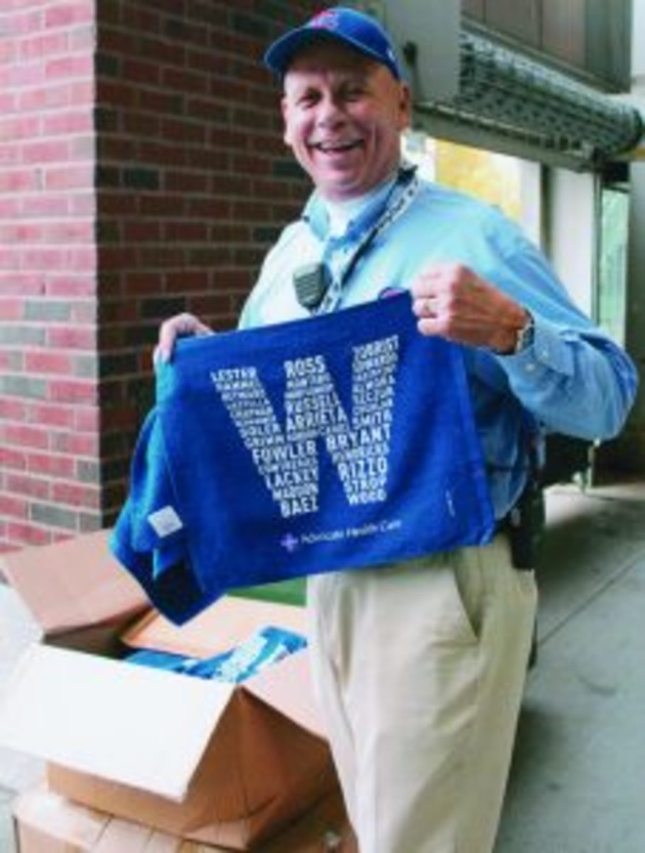 "A blue ""W"" towel was given to fans entering Wrigley Field."