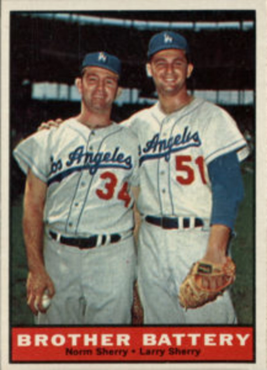 Brothers Larry and Norm Sherry both played for the Los Angeles Dodgers and were included on the same card in the 1961 Topps Baseball set.