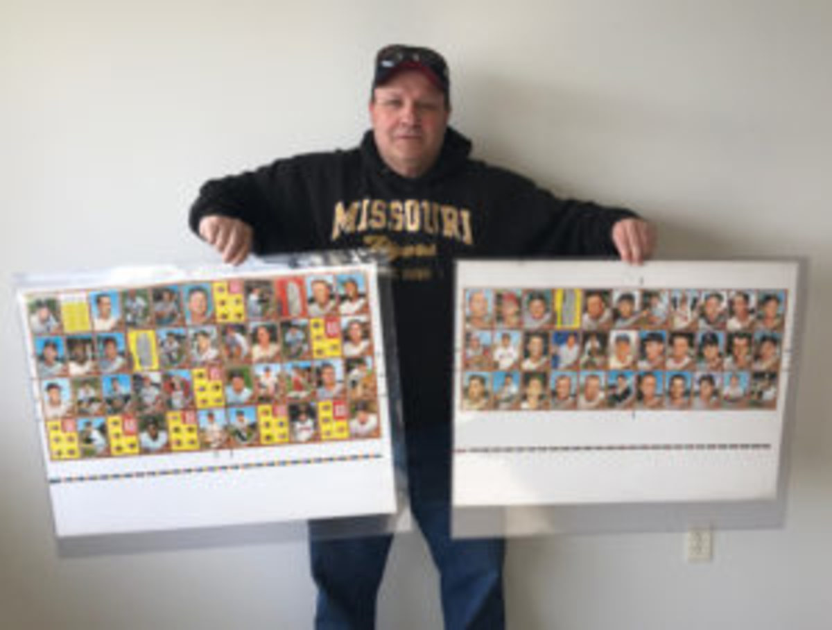 Rick Giddings shows two of the 1962 Topps Baseball card uncut sheets he recently was made aware of and purchased. (Bert Lehman photo)