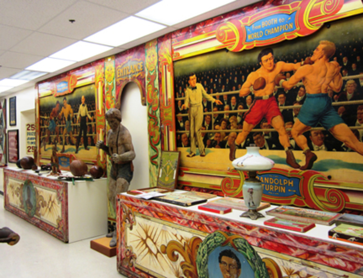 A colorful mural of boxing matches was rescued from an amusement park booth.
