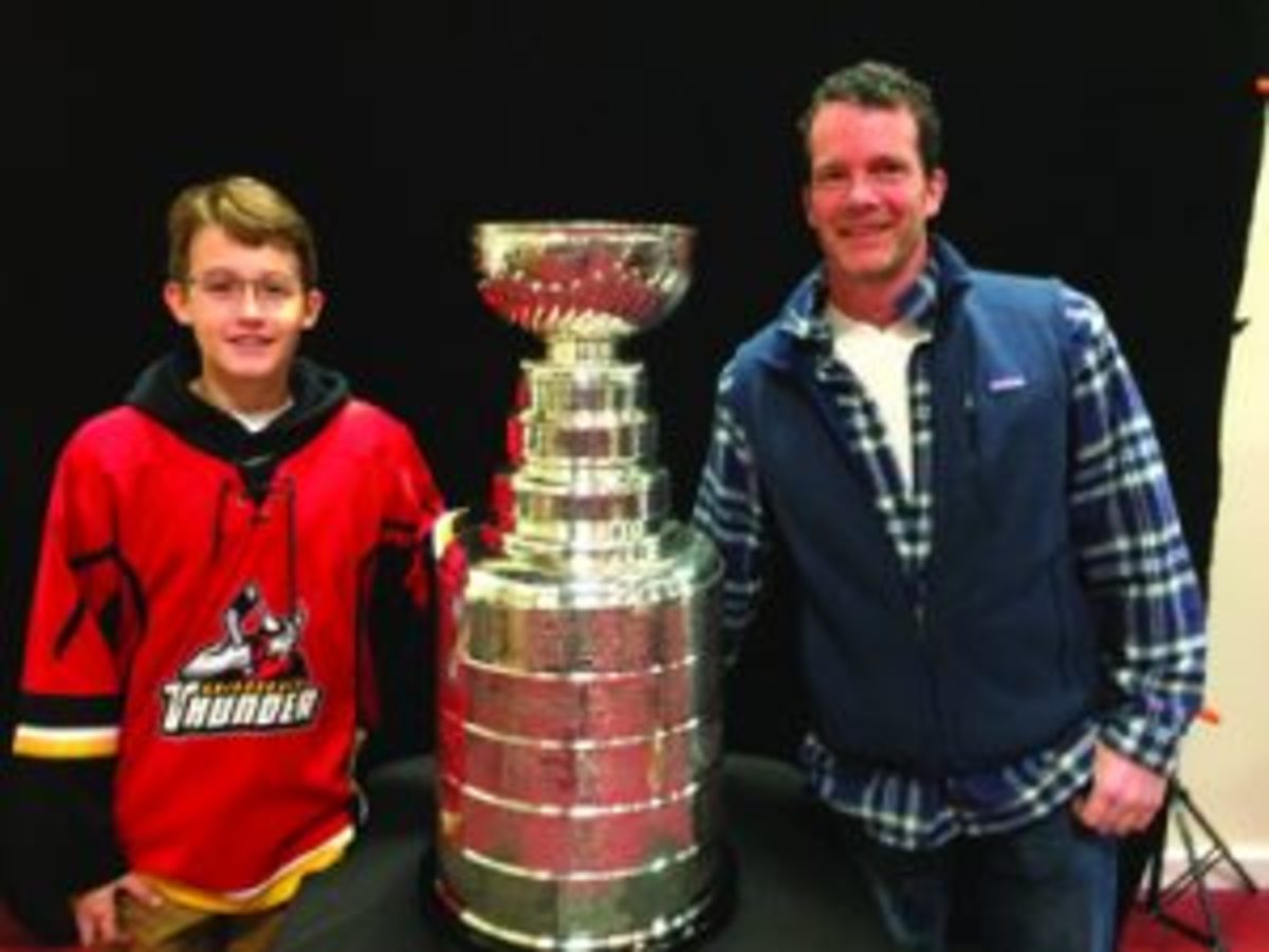Roman Poganowski and his dad Bill of Lake George, New York with the Stanley Cup.