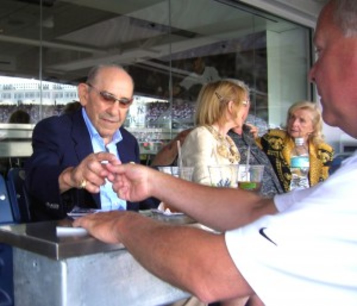 Autographs from the likes of Yogi Berra are commonplace during Old-Timers' Day.