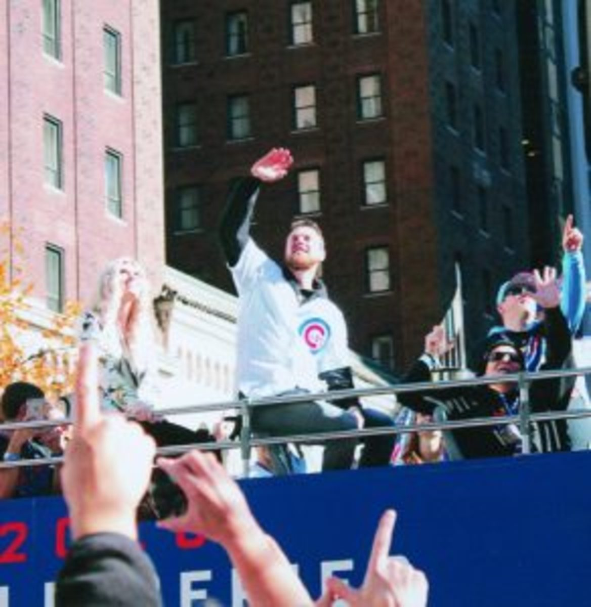 World Series MVP Ben Zobrist waves to the crowd while riding the parade bus.
