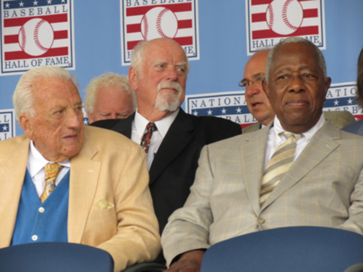 On hand for the induction festivities were Ralph Kiner, left, and Hank Aaron, with Gaylord Perry in rear.