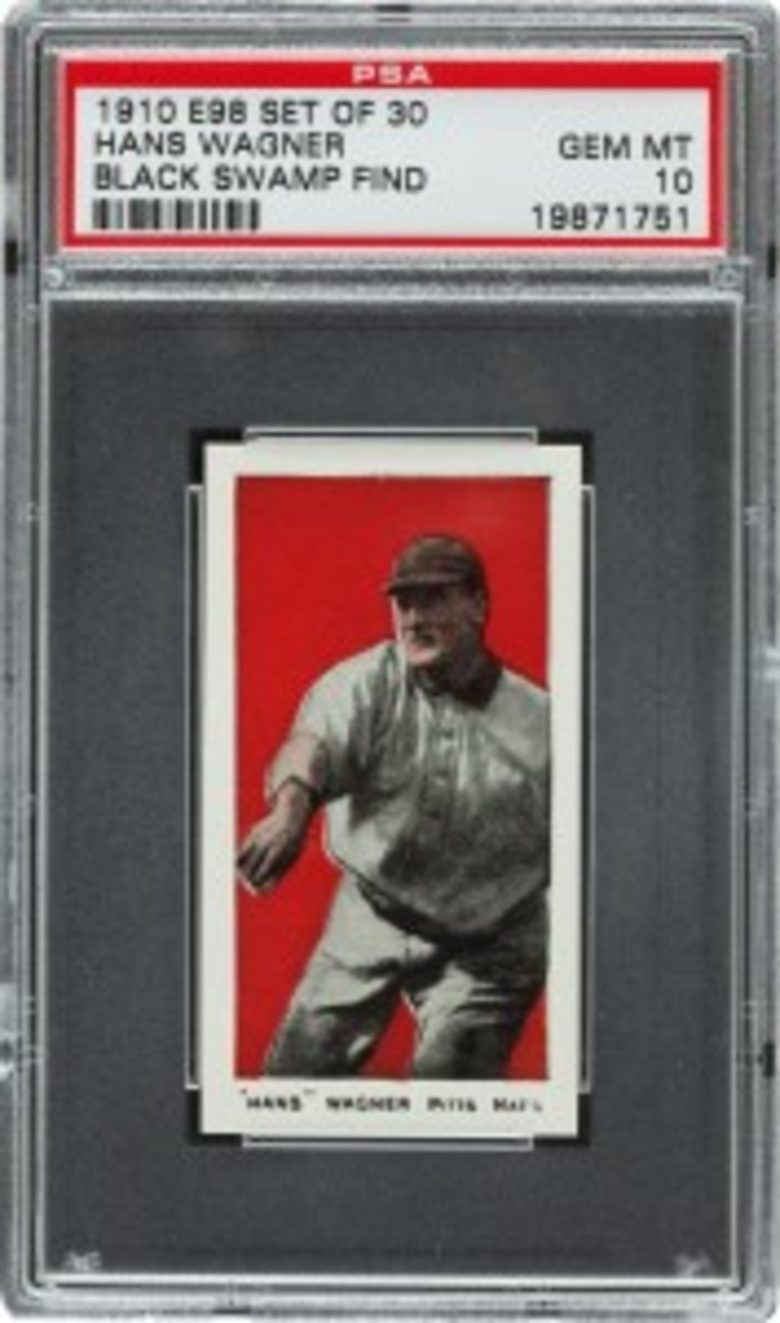 "Recently discovered in a Defiance, Ohio house attic with over 700 other well-preserved 1910 era E98 series baseball cards, this card of Hall of Fame player Honus (""Hans"") Wagner has been certified PSA Gem Mint 10 and is expected to sell for $200,000 or more in an auction conducted by Heritage Auctions on August 2, 2012. (Photo courtesy of Heritage Auctions.)"