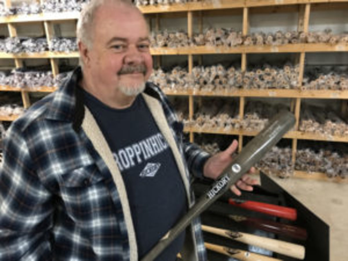 Jon Moyer, founder of Old Hickory Bat Company, proudly holds up a bat made for J.D. Martinez of the Boston Red Sox.