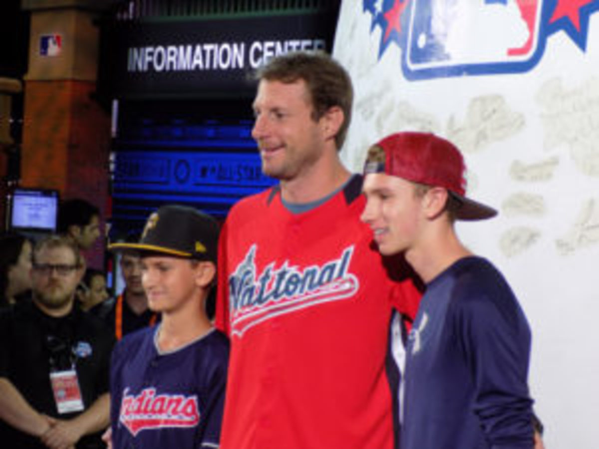 All-Star game pitcher Max Scherzer of the Washington Nationals with two young fans.