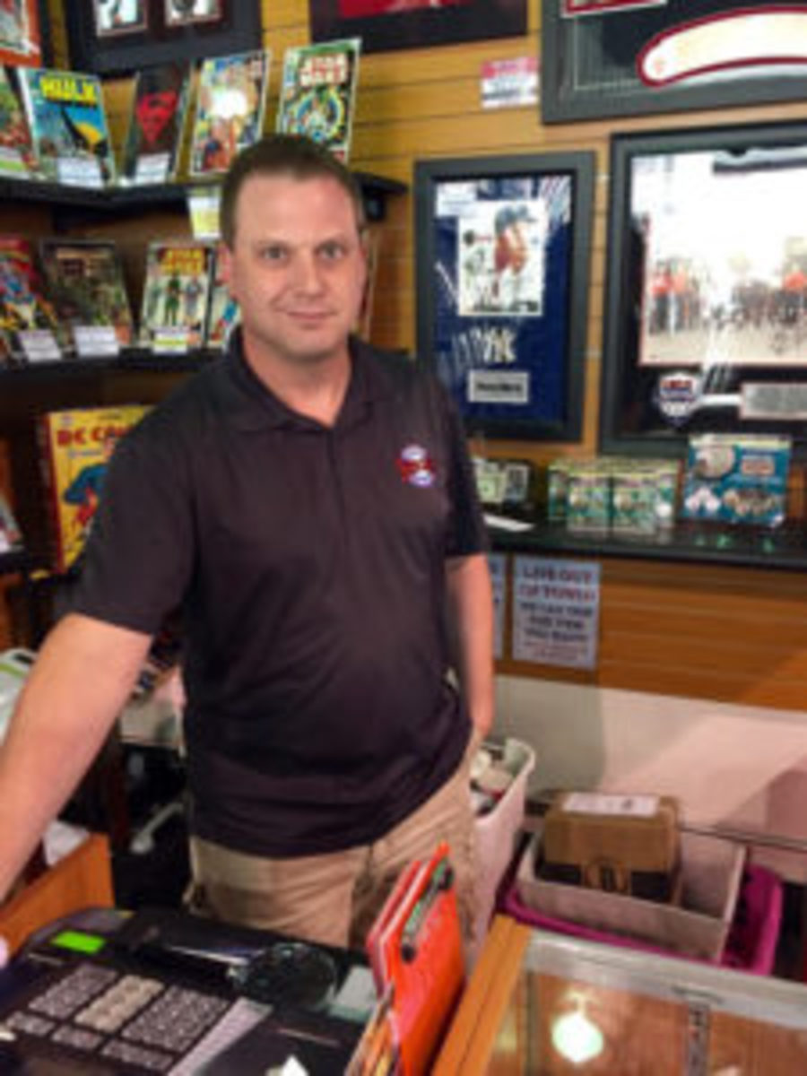 """Jeremy Brown, owner of Ultimate Sports Cards and Memorabilia in Las Vegas, is also a sports memorabilia expert on the TV show """"Pawn Stars."""" (Kevin Nelson photos)"""