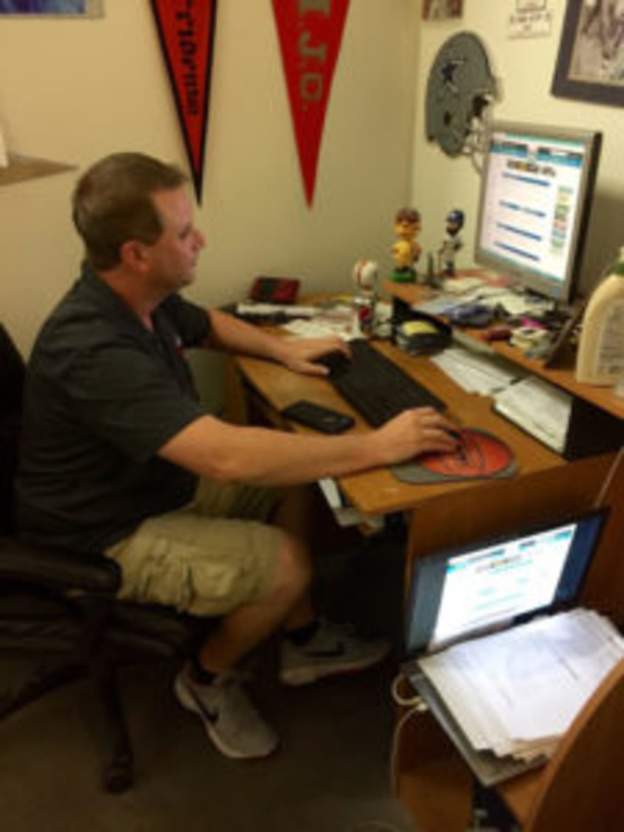 Jeremy Brown checks a fact on his office desktop in his office.