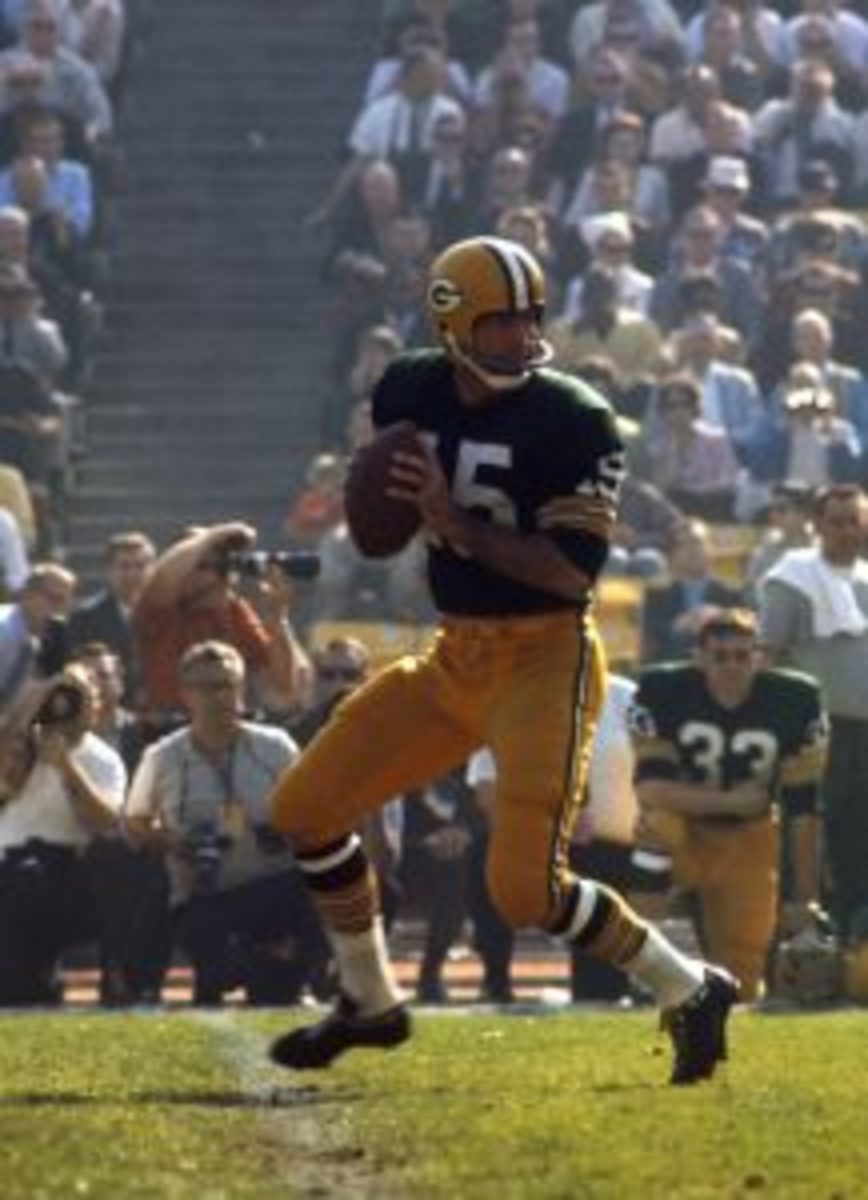 Green Bay Packers Hall of Fame quarterback Bart Starr (15) drops back to pass during Super Bowl I, a 35-10 victory over the Kansas City Chiefs on January 15, 1967, at the Los Angeles Memorial Coliseum in Los Angeles, California. (Photo by James Flores/Getty Images)