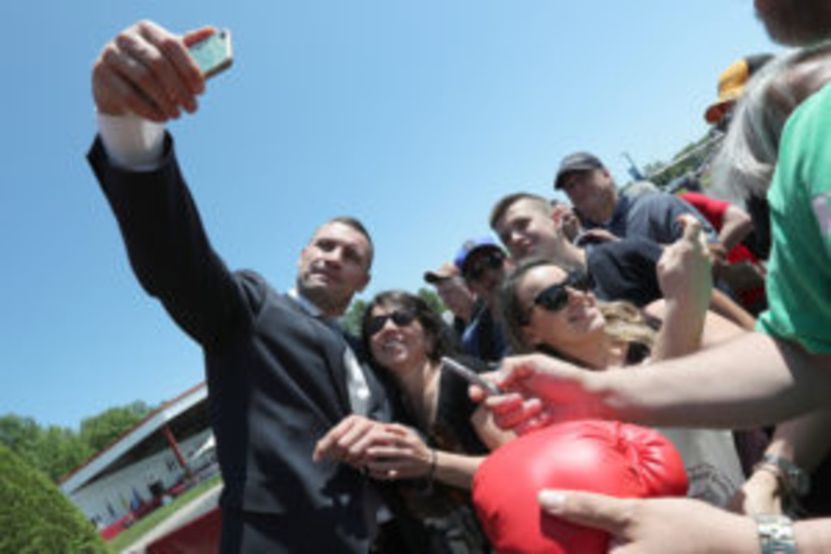 2018 inductee Vitali Klitschko takes a photo with a fan prior to the 2018 induction ceremony at the International Boxing Hall of Fame for the Weekend of Champions event on June 10, 2018 in Canastota, New York. (Photo by Alex Menendez/Getty Images)