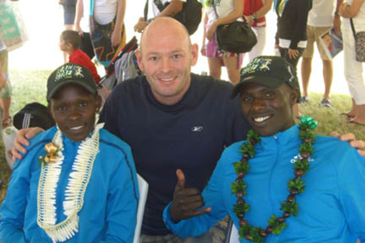 The author, Ross Forman, poses with Joyce Chepkirui and Wilson Chebet, winners of the 2014 Honolulu Marathon, in which Forman also participated. Marathon runners are just some of the big-time athletes that frequent the islands, while many professional athletes are natives to Hawaii.