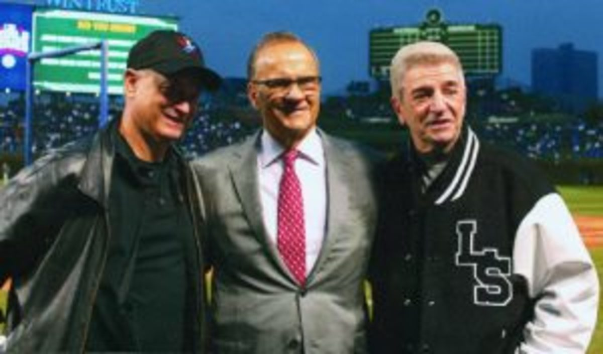 Gary Sinise (left), Joe Torre (center) and Tom Dreesen (right) take time to pose for a photo at Wrigley Field.