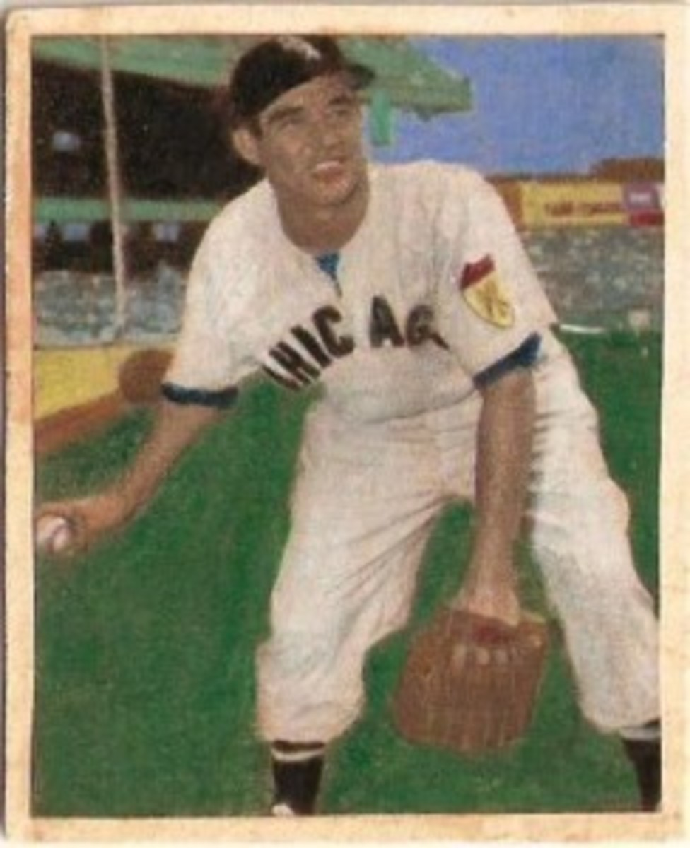 Chico Carrasquel has a newer Sox hat but the back of the card lists him as a Cleveland Indian. He was traded to Cleveland in October 1955.