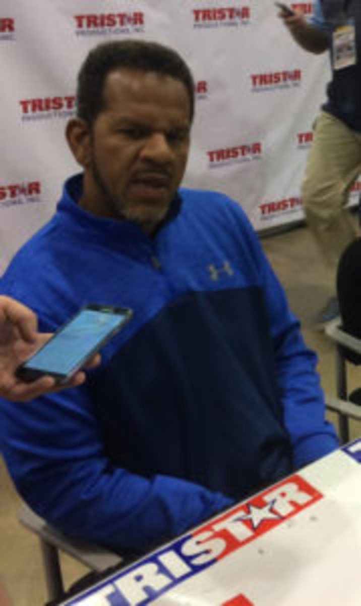 Andre Reed takes a break from signing autographs at The National in 2017 to do an interview.