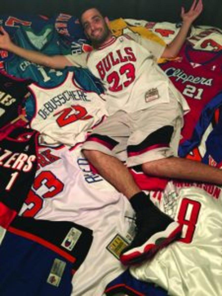Andrew Polaniecki with jerseys
