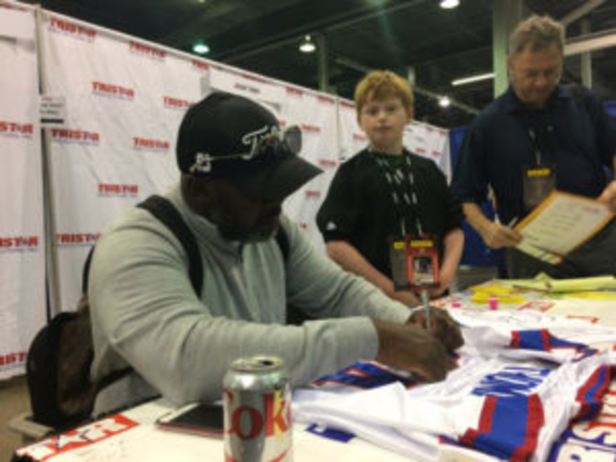 Thurman Thomas signs a jersey for a fan at The National in Chicago in 2017.