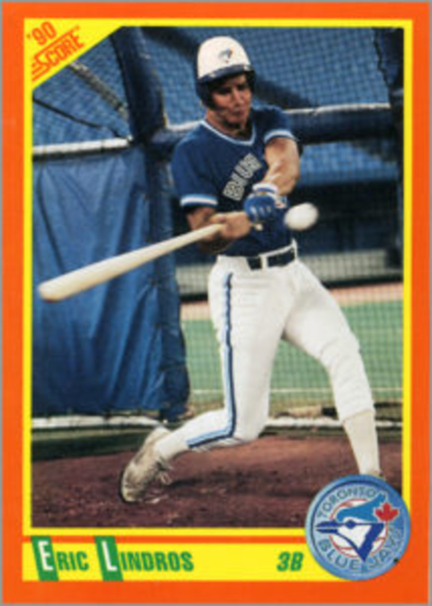 """In its 1990 """"Rookie and Traded"""" Baseball set, Score released a card of Eric Lindros featuring a photo of him taking batting practice with the Toronto Blue Jays."""