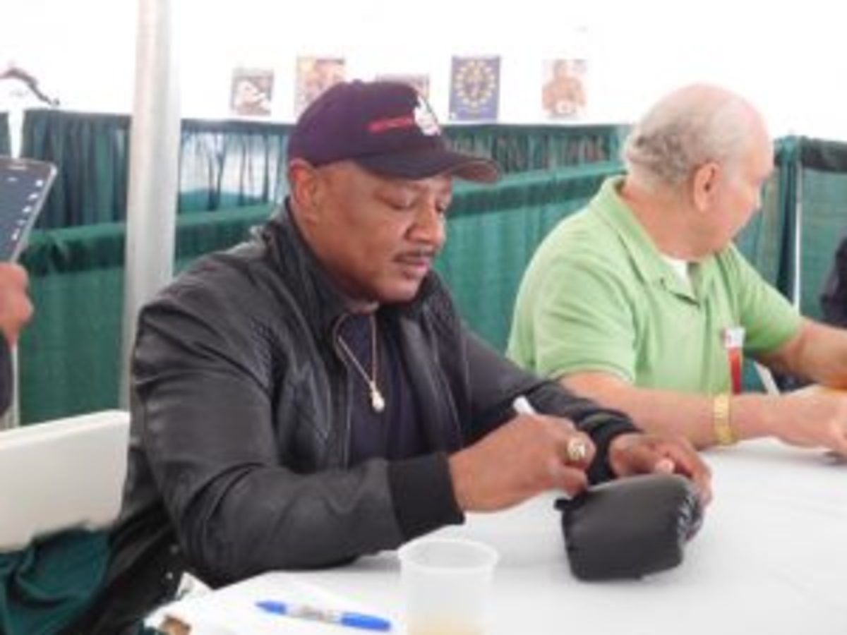 Marvelous Marvin Hagler signs an autograph at the Hall of Fame golf event. (Photos by Robert Kunz)