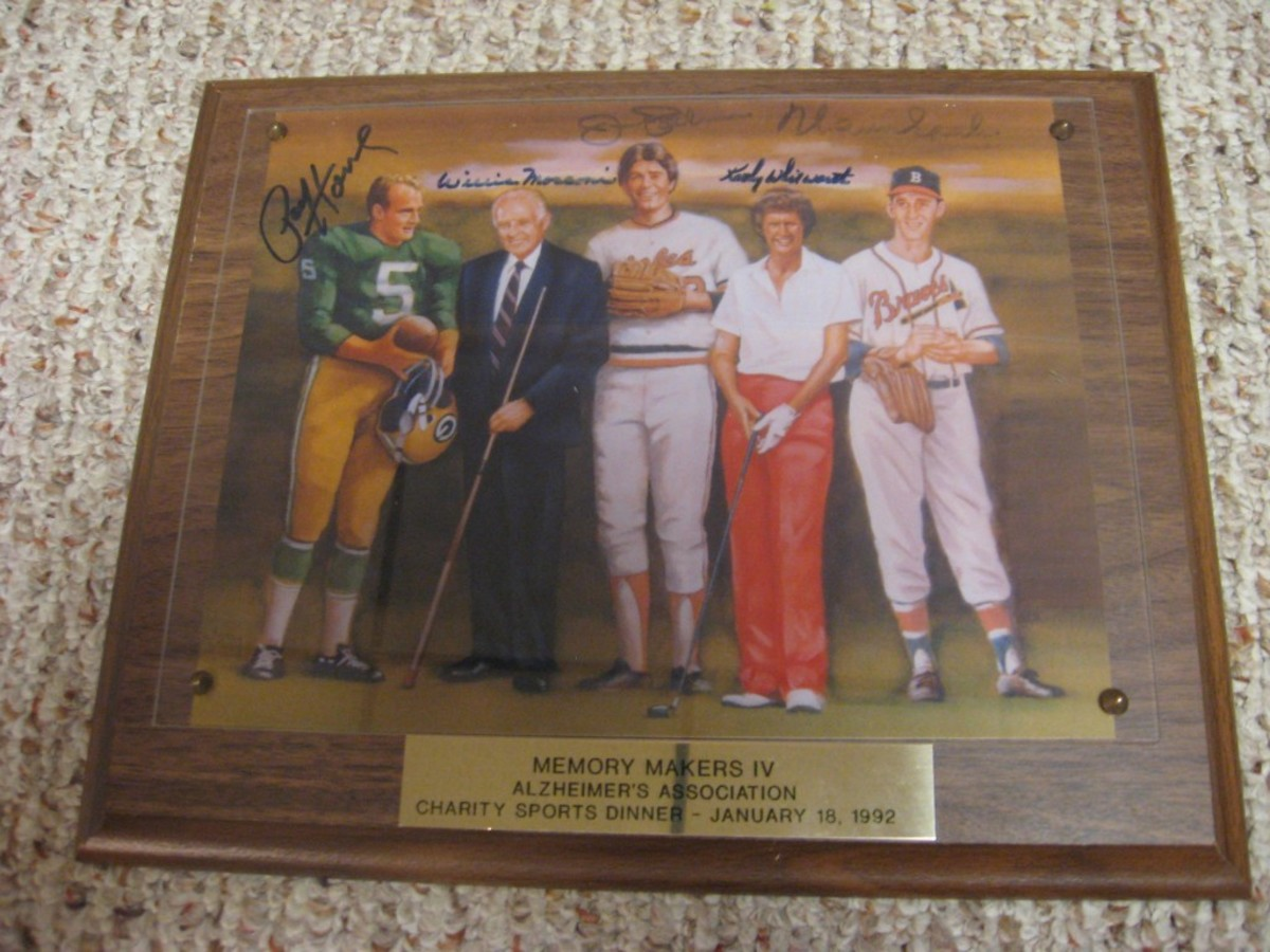 Charity signed pieces are some of the best. This Alzheimer's Association dinner piece is signed by Paul Hornung, Willie Mosconi, Cathy Whitworth, Jim Palmer and Warren Spahn. The item was found at a thrift store for $3.99.