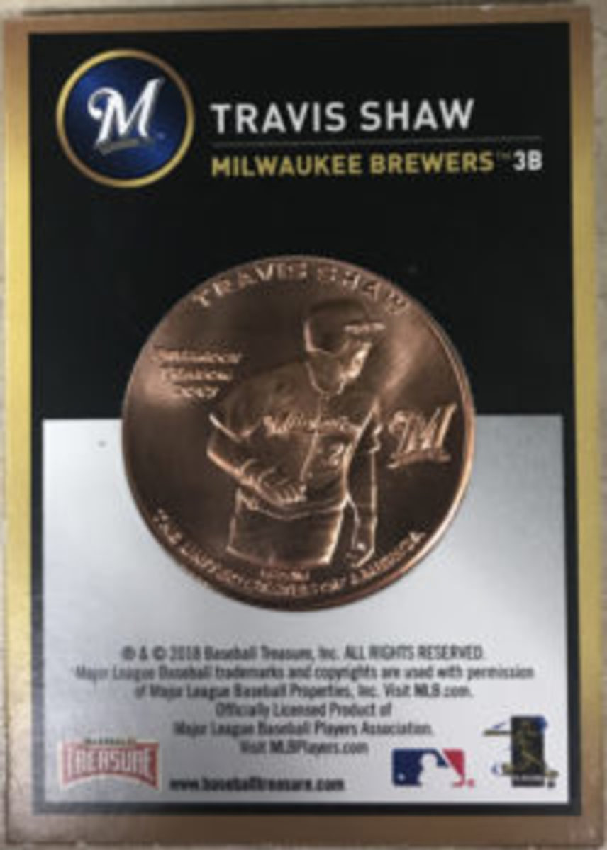 The back of the coin features an action shot of the named player. The coin comes in a full color cardboard mount.