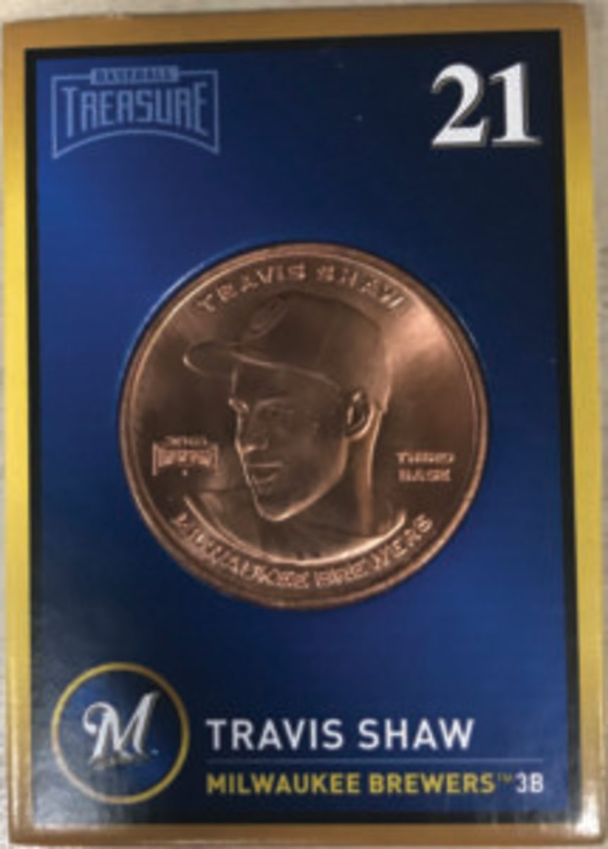 The front of the Baseball Treasure coins feature a portrait of the named player.
