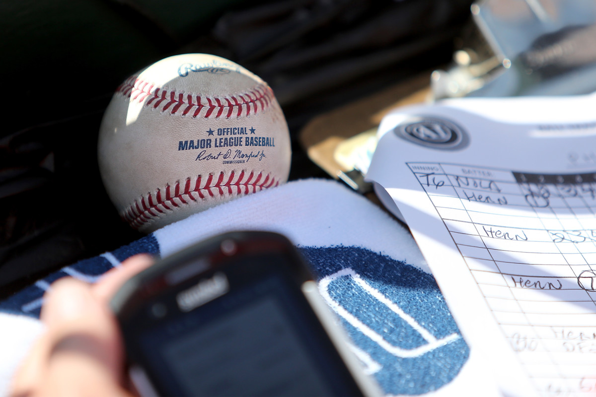 A game-used baseball awaits authentication by an MLB authenticator during a game between the Cardinals and the Phillies in May 2018. Photo: Scott Kane/Getty Images