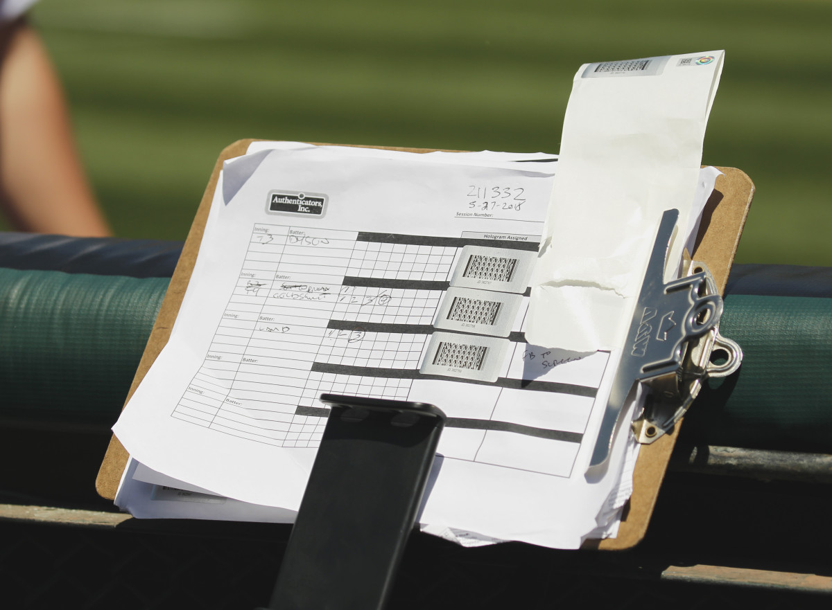 A clipboard shows the authentication stickers for the baseballs in a game between the Diamondbacks and the A's in May 2018. Photo: Larry Placido/Icon Sportswire via Getty Images