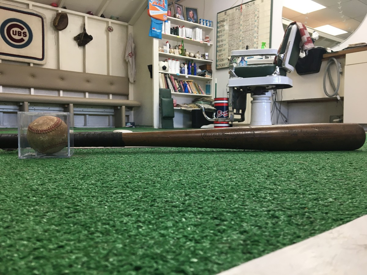 Babe Ruth ball and bat, and Shaffer's barber chair surrounded by other sports memorabilia