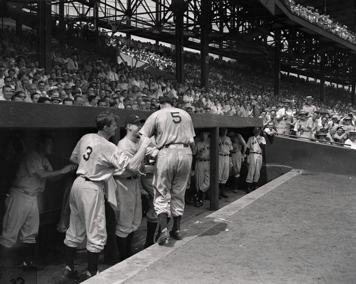 Selkirk wearing Babe Ruth's old No. 3 jersey congratulating Joe DiMaggio (No. 5) coming back into the dugout. Photo: Bettmann/Getty Images