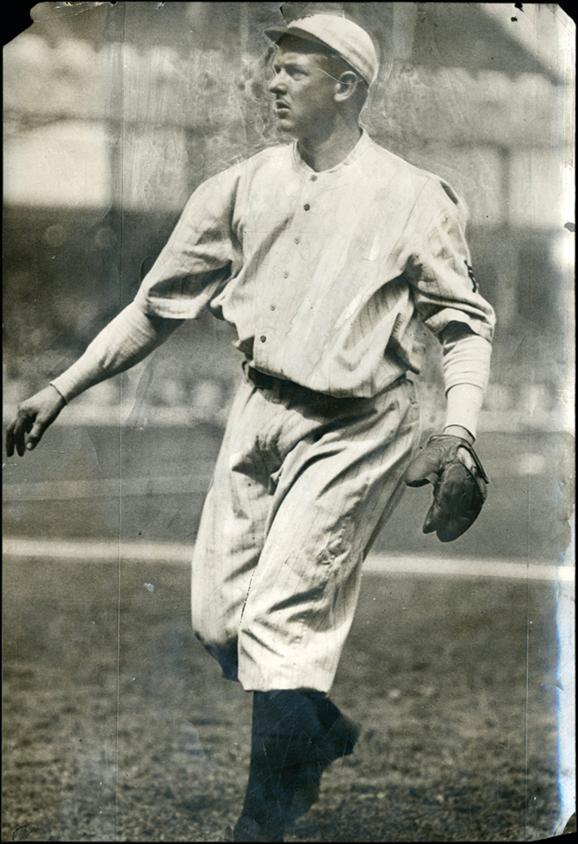 """Christy Mathewson Photograph by Charles Conlon:Taken by the legendary Charles Conlon, this original Type I photo features Hall of Famer Christy Mathewson doing what he does best, throwing a baseball. The 6.25x9.25"""" photo is highlighted with some cropping marks along with Conlon's writing on the reverse in pencil. Corners have some chipping."""
