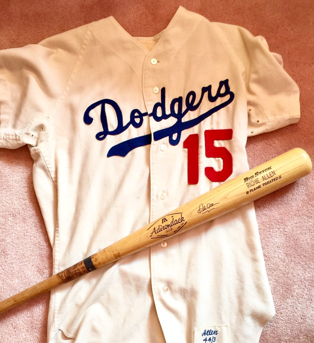 A 1971 L.A. Dodgers home flannel jersey and bat