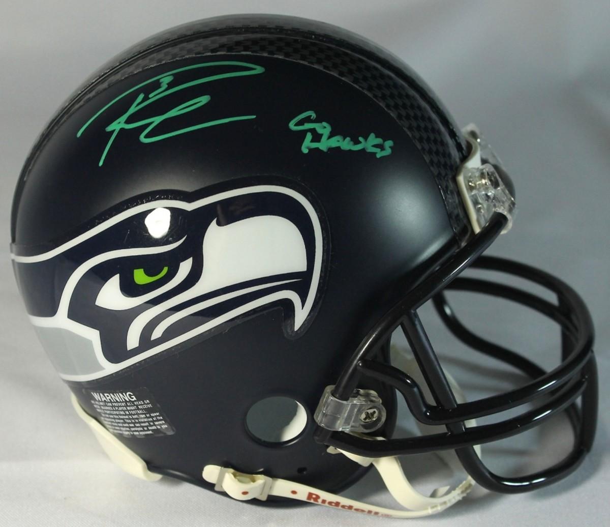 A Forged Russell-Wilson-Signed-Seahawks-Mini-Helmet-Inscribed-Go-Hawks-Wilson-Hologram