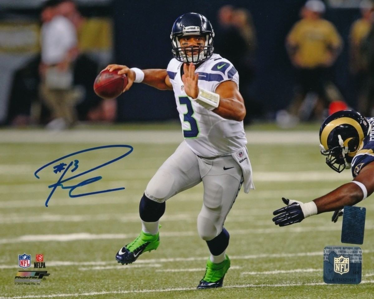 """Pictures """"signed"""" by Russell Wilson were part of the hundreds of items sent to Mill Creek Sports after they were discovered to be fake. Photo: Mill Creek Sports"""
