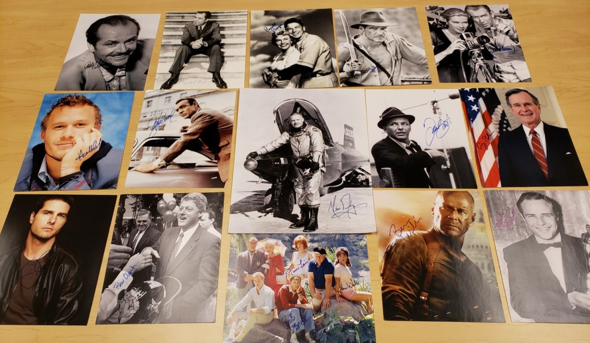 Forged autographed photos seized during the John Rogers Investigation. They included Frank Sinatra, Tom Cruise, Harrison Ford and Marlon Brando. Photo: FBI