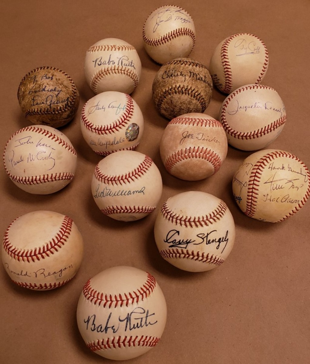 An assortment of forged autographed baseballs seized during the John Rogers investigation. They include forged autographs of Babe Ruth, Christy Mathewson, Ted Williams, John Lennon, Paul McCartney, Jacqueline Kennedy and Ronald Reagan. Photo: FBI