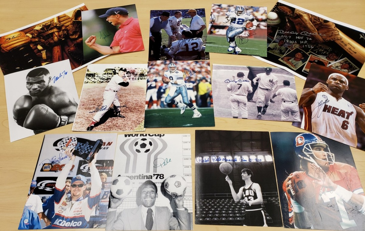Forged autographed sports photos seized during the John Rogers Investigation. They included Tiger Woods, Troy Aikman, LeBron James, Mike Tyson and Pele. Photo: FBI