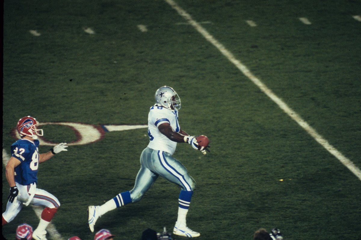 As he returns a fumble recovery, Cowboys defensive tackle Leon Lett holds the football out in a premature celebration near the 10-yard line only to have it stripped away by Bills receiver Don Beebe before the goal line. Photos: Gin Ellis/Getty Images