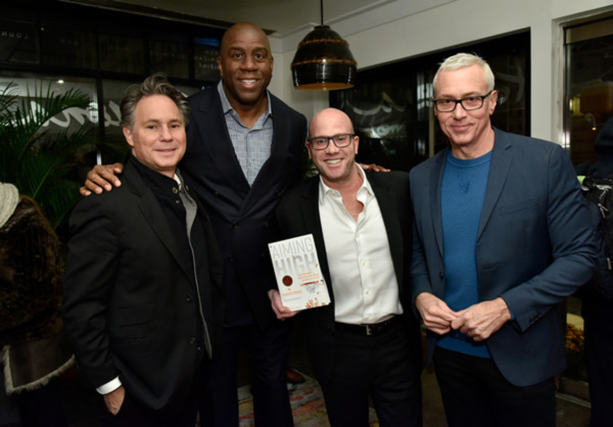 Among Prince's supporters are (from left) Jason Binn, publisher of Dujour Media, Magic Johnson and Dr. Drew Pinsky.
