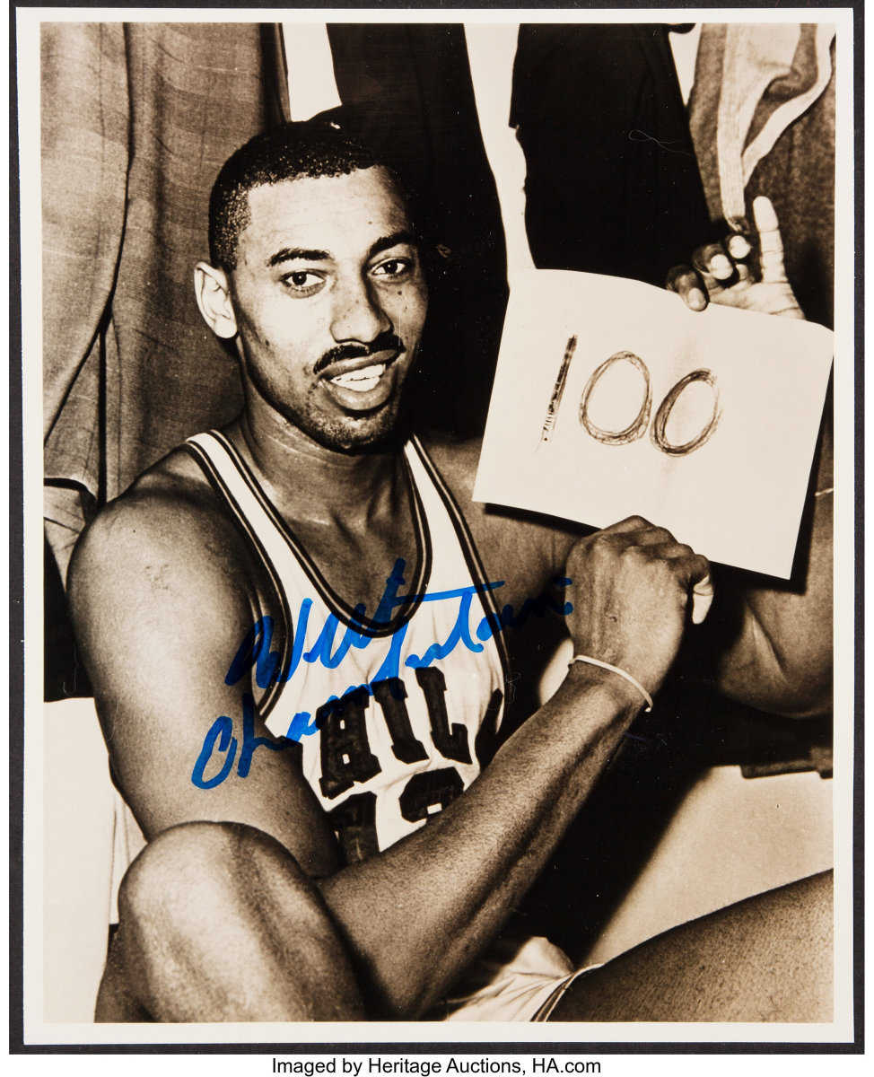Iconic photo taken by Associated Press photographer Paul Vathis was autographed by Wilt Chamberlain. It sold at Heritage Auctions for $492 in November 2019. Photo: Heritage Auctions