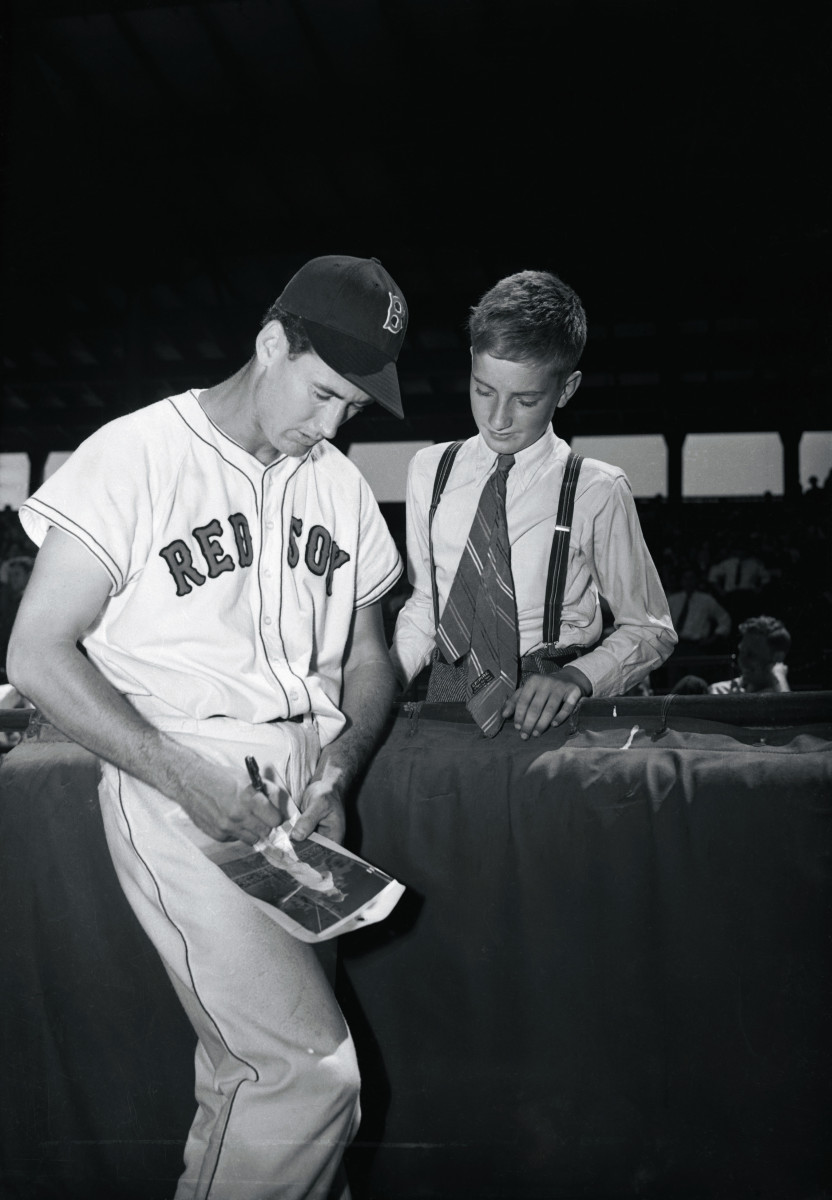 Ted Williams autographs a photo for a 13-year-old birthday boy in 1948. Photo: Bettmann/Getty Images