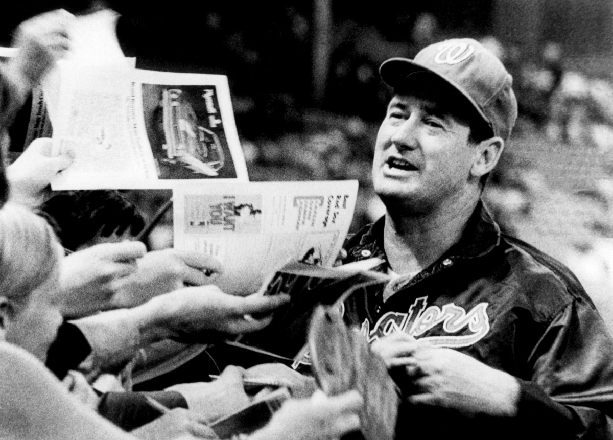 As manager of the Washington Senators in 1969, Williams is deluged by autograph seekers when he returns to Fenway Park. Photo: Bruce Bennett Studios via Getty Images