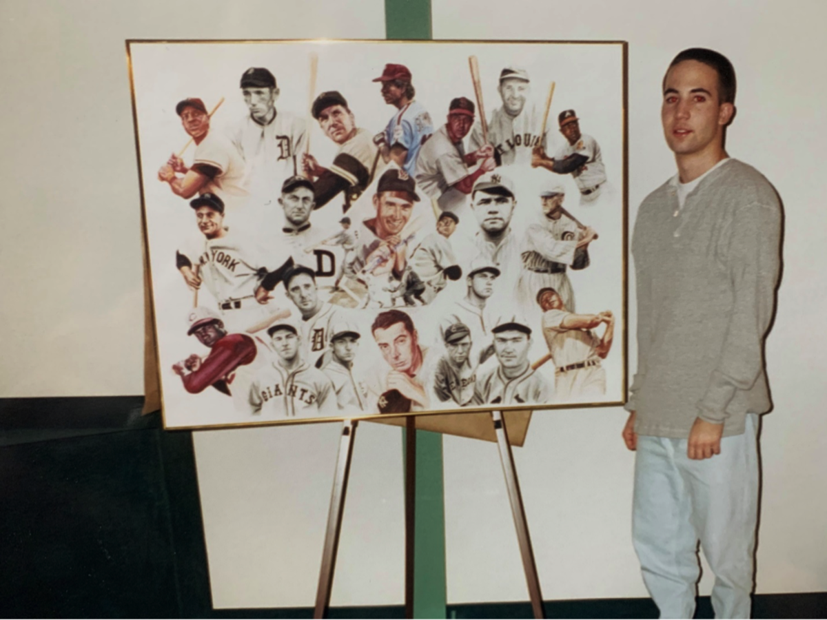 Fiorentino standing next to orginal painting, which hung for a while in the home of Ted Williams. Photo credit: James Fiorentino