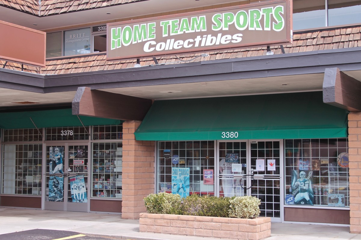 Home Team Sports Collectibles follows non-essential business closure in Reno, Nev., with a sign in the window sending customers to its Facebook and Instagram accounts. The shop conducts online breaks and sells on eBay.