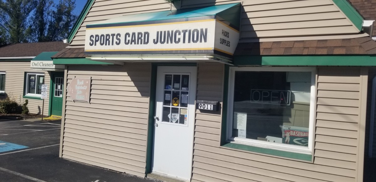 "The ""Open"" sign in the window of Sports Card Junction in Pittsburgh is dark, as many card shops around the country are forced to close."