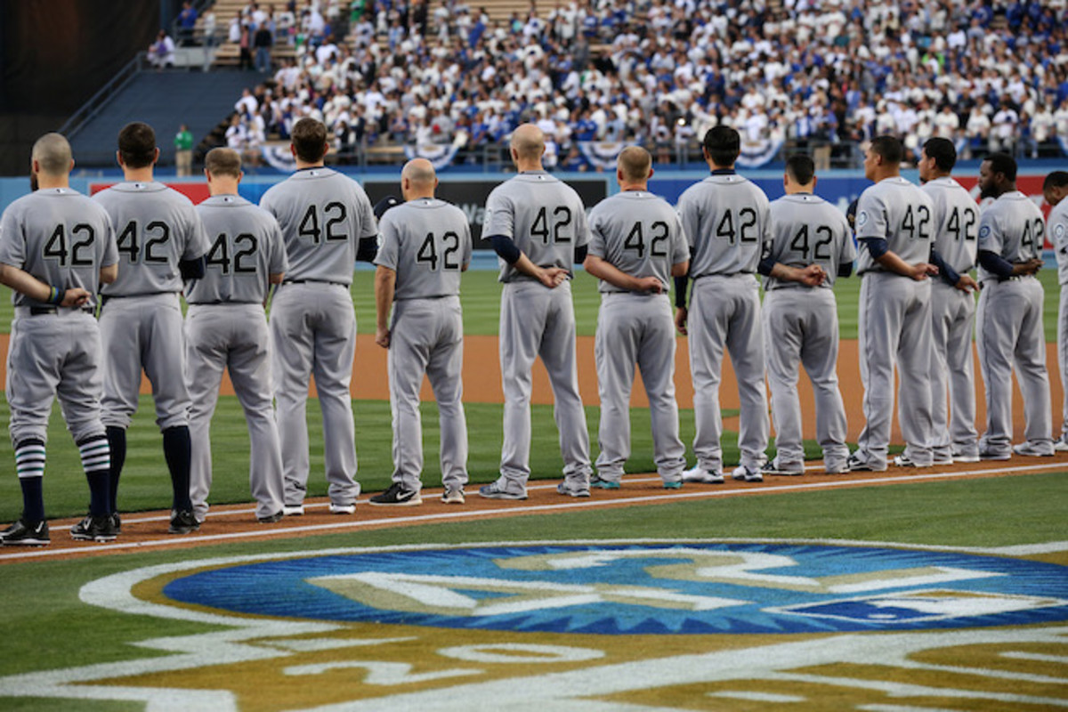 The Seattle Mariners line up for pregame ceremonies for Jackie Robinson Day at Dodger Stadium on April 15, 2015. Photo: Stephen Dunn/Getty Images