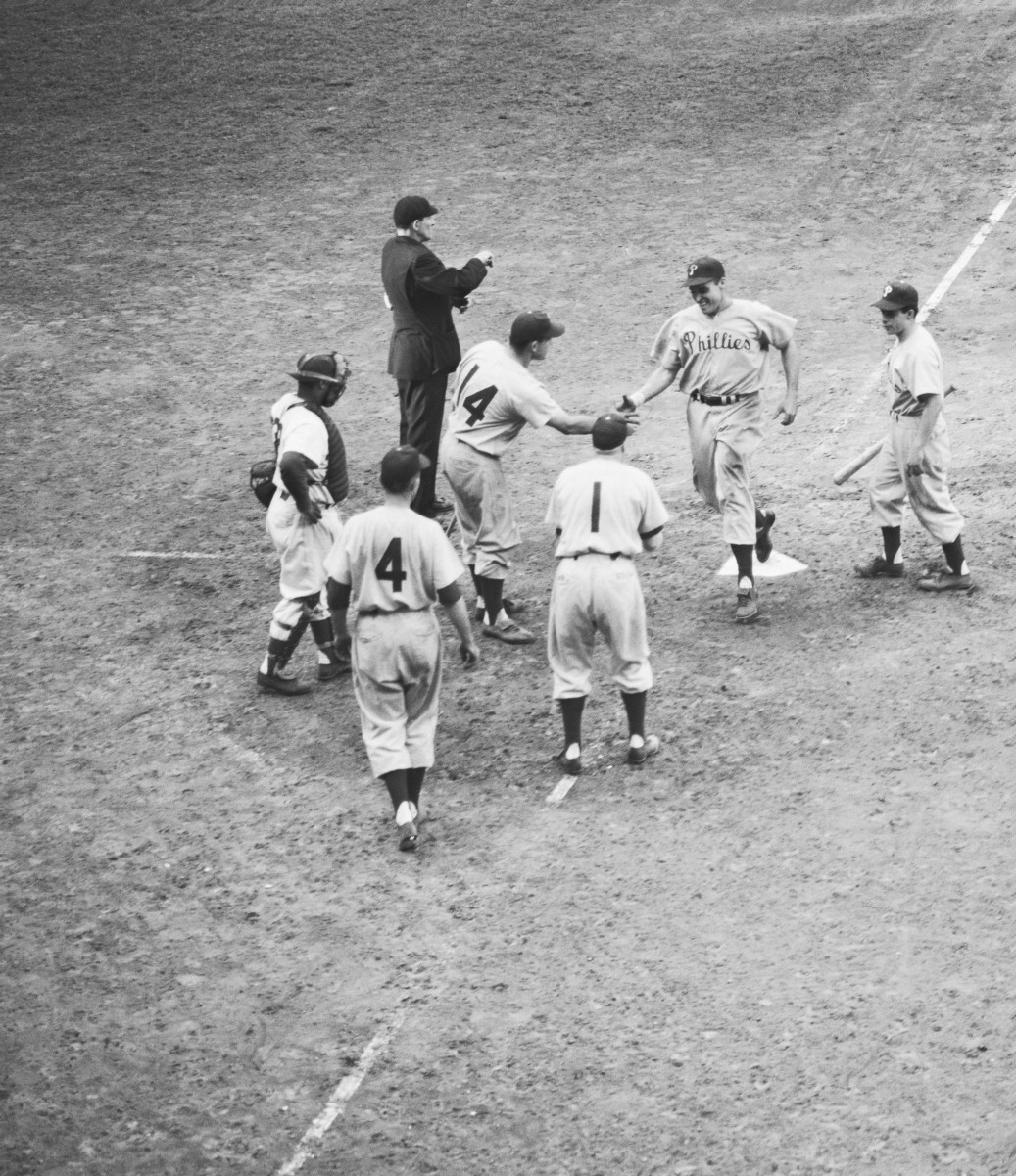 Philadelphia's Dick Sisler hits the game-winning, three-run home run in the top of the 10th inning against the Brooklyn Dodgers on Oct. 1, 1950 to clinch the pennant for the Phillies on the last day of the regular season. Photo: Bettman/Getty Images