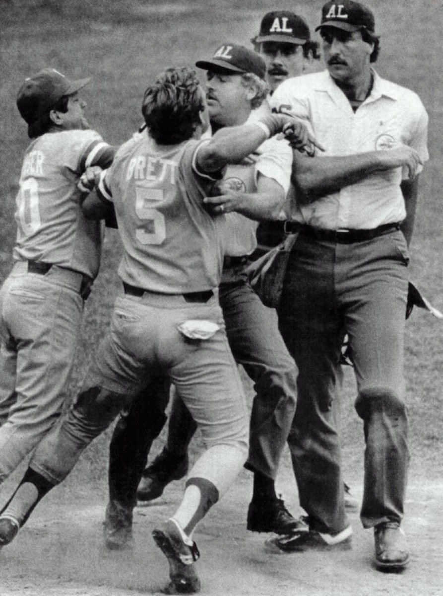 "George Brett, trying to get at home plate umpire Tim McClelland after he was called out following his ""pine tar"" home run, is held back by umpire Joe Brinkman. Kansas City Royals manager Dick Houser also argues. Photo: Sporting News via Getty Images"