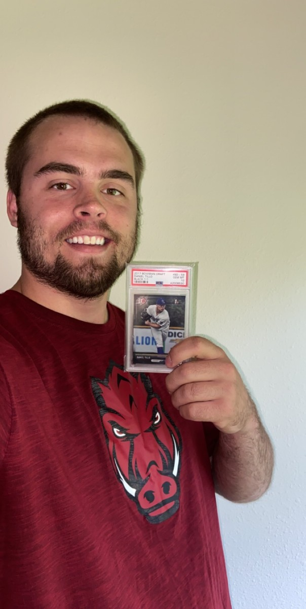 Tillo holds his 2017 Bowman Draft paper black border 1/1 a fan on Twitter sent him.